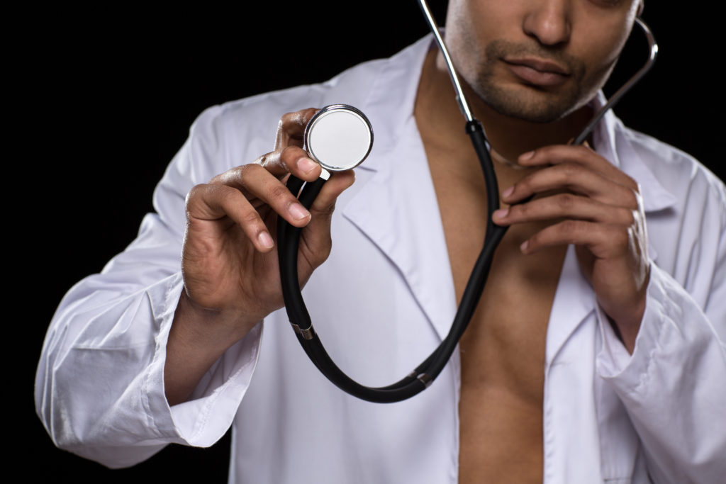 Man in medical outfit - doctor/patient role play scenario